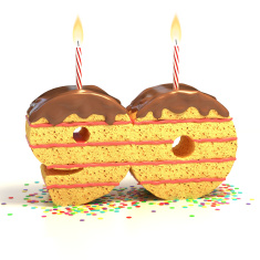 stock-photo-39110310-number-90-shaped-chocolate-birthday-cake-with-lit-candle